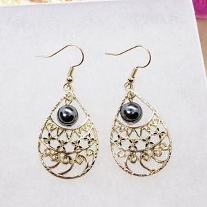 Hawaiian wave teardrop pearl earrings